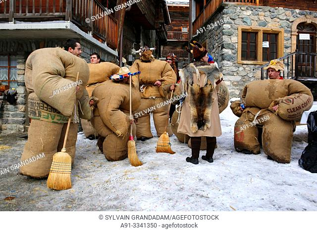 "Switzerland, Valais, Val d'Herens, village of Evolene, Carnaval, preparation of the ""empailles"" ( young men dressed with old bags stuffed with about 50 kgs of..."