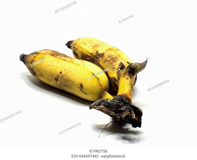 Cultivated banana on the white background (Isolated & clipping part). The yellowish and black color is caused by the old banana