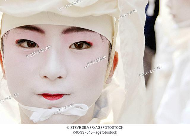 Girl in traditional costume. Hanagasa Junko (Procesion of floral bonnets). Gion Matsuri (Traditional japanese festival). Kyoto. Japan