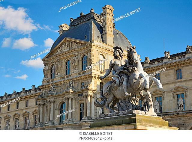France, Ile-de-France, Paris, Equestrian statue of King Louis XIV by Bernini on the Napoleon Courtyard of the Louvre Museum and Pavillon Richelieu