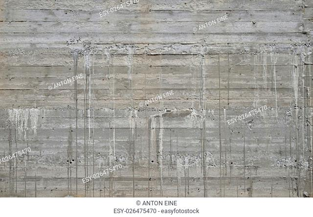 Concrete wall texture with wooden pattern impress from wooden form board shuttering and with sags of cement