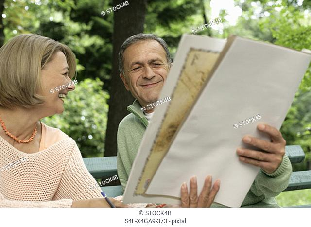 Mature woman showing man her drawing