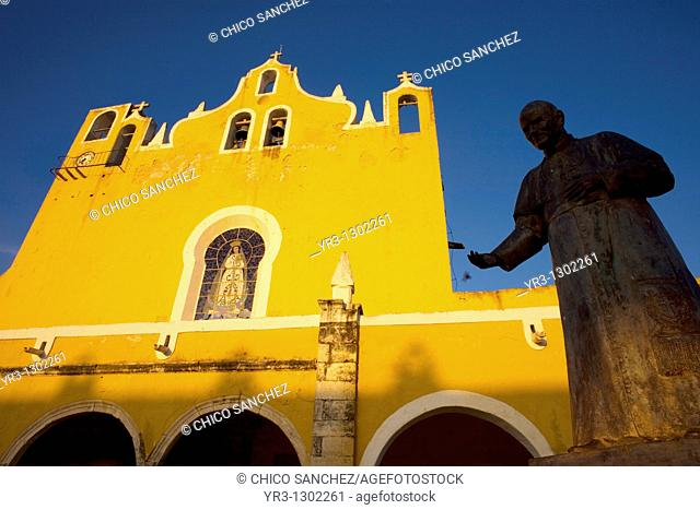 A statue of Pope John Paul II is displayed ant the entrance of the San Antonio de Padua convent in Izamal village on Mexico's Yucatan peninsula, June 27, 2009