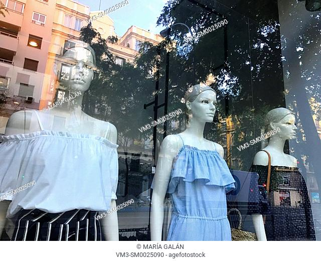Three mannequins in a shop window. Madrid, Spain