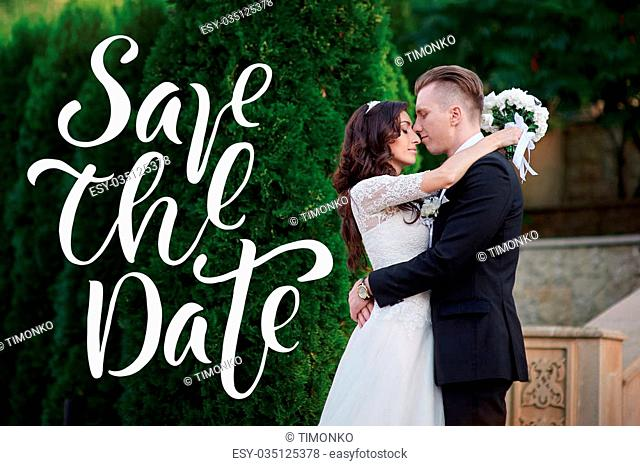 Bride and groom at wedding Day walking Outdoors on spring park and words Save the Date