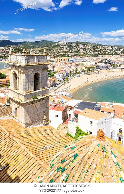 Views over the Hermitage of Our Lady of the Ermitana bell tower, and old town towards waterfront beach side hotels of Playa Norte, Peniscola, Castellon