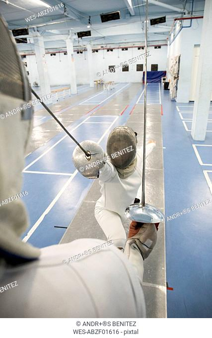 Female fencer during a fencing match