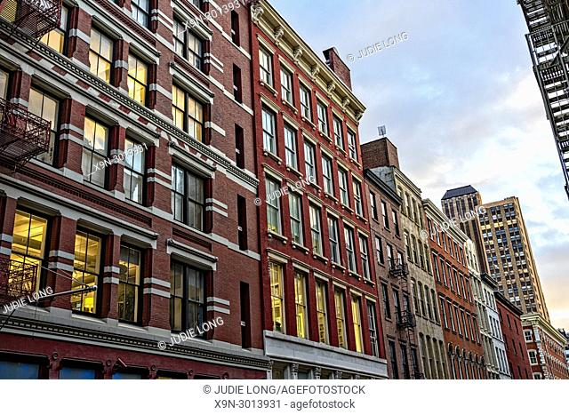 New York City, Manhattan, Soho. Looking South on Mercer Street at Cast Iron Buildings. Typical Soho Architecture