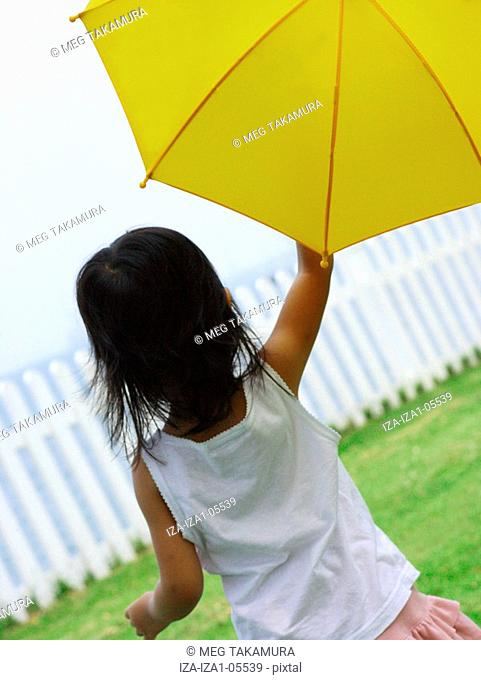 Rear view of a girl holding an umbrella