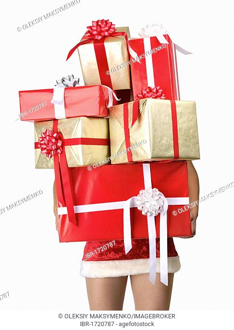 Woman with lots of Christmas gifts with only legs visible