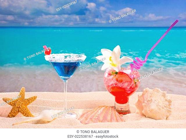Beach tropical red and blue cocktail on caribbean white sand