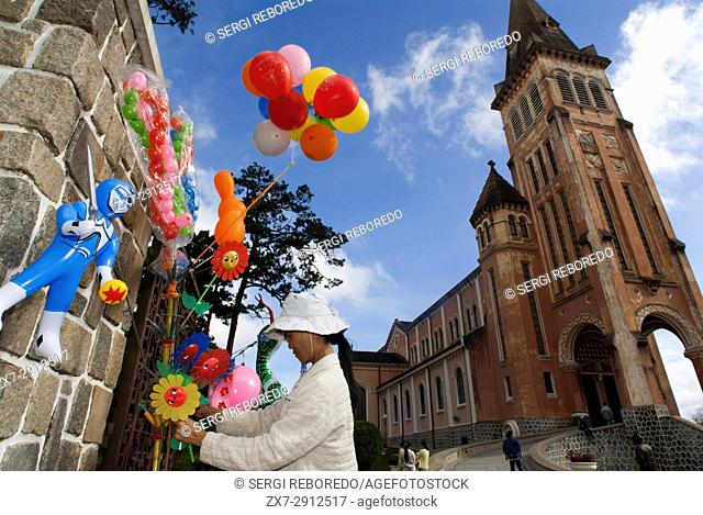 Notre Dame Cathedral, Ho Chi Minh City (Saigon), Vietnam, Indochina, Southeast Asia. People sell balloons outside of the Notre Dame Cathedral in city centre of...