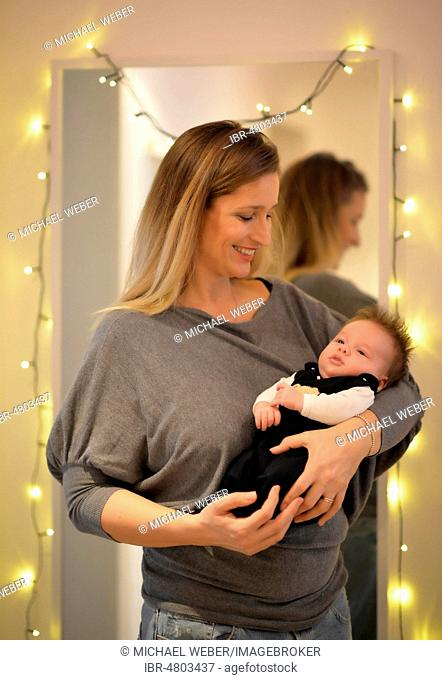 Proud mother keeps infant, 6 weeks, Germany