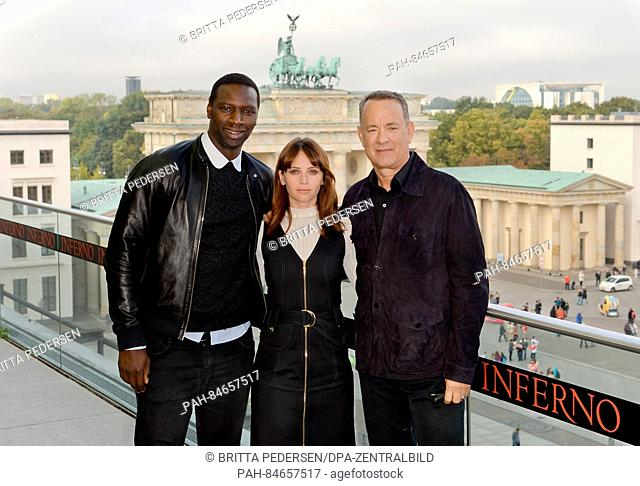 French actor Omar Sy (L-R), British actor Felicity Jones and American actor Tom Hanks in front of the Brandenburg Gate during the 'Inferno' photocall in Berlin