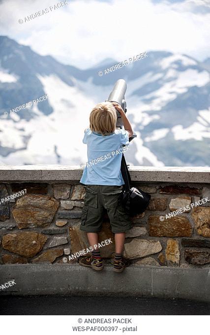 Austria, Grossglockner, Young boy watching through a binocular