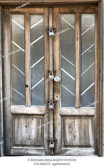 Old door locked with 4 padlocks - Bucharest, Romania