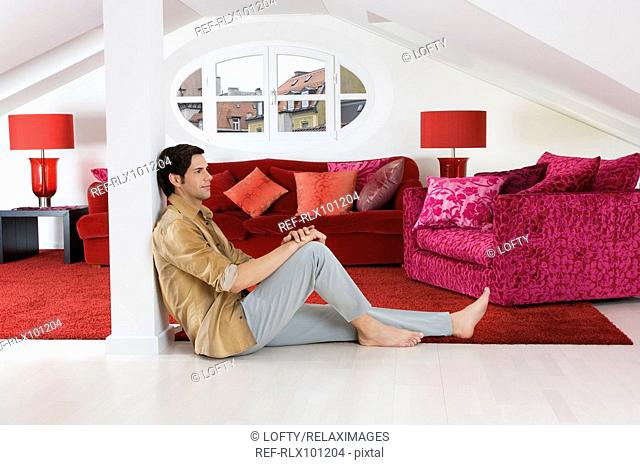 Man sitting on living room floor