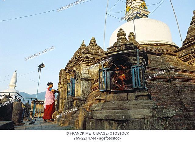 Woman worshiping a Newari deity. Kirtipur, Nepal. Newari are the original inhabitants of the Kathmandu valley