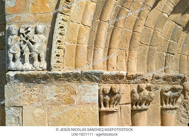 Detail of entrance to San Pedro collegiate, in Cervatos village, Campoo de Enmedio, considered as one of the most important romanesque churches of Cantabria and...