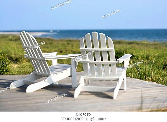 Adirondack chairs on deck looking towards beach on Bald Head Island, North Carolina