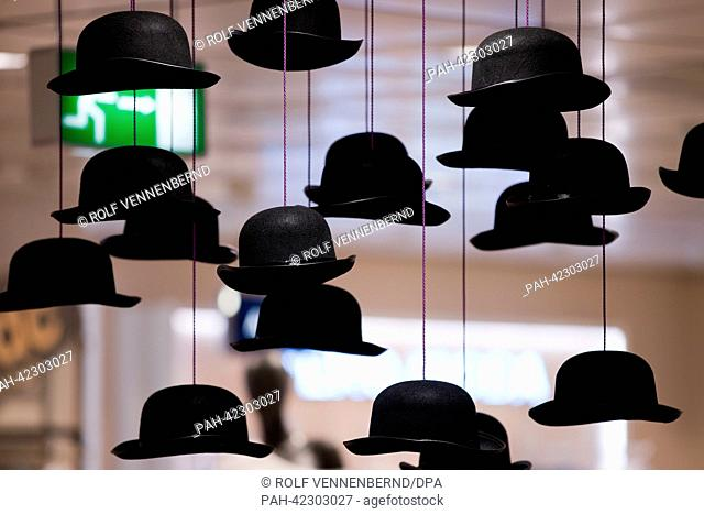 British hats hang from the ceiling at a newly renovated Karstadt shop in Duesseldorf, Germany, 04 September 2013. The chain of warehouses Karstadt enters the...