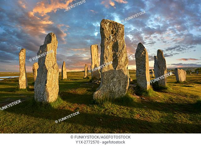 Calanais Standing Stones central stone, at sunset, circle erected between 2900-2600BC measuring 11 metres wide. At the centre of the ring stands a huge monolith...