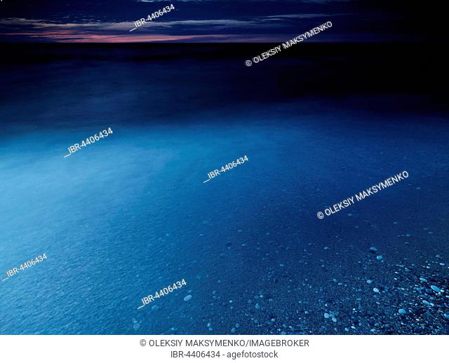 Clear dark blue glossy water of lake Huron at dusk, Pinery Provincial Park, Grand Bend, Ontario, Canada