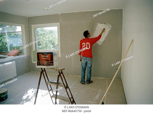 A man painting a wall