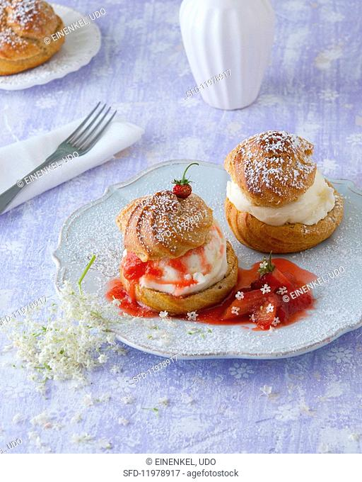 Profiteroles with vanilla ice cream, strawberry and rhubarb compote and elderflowers