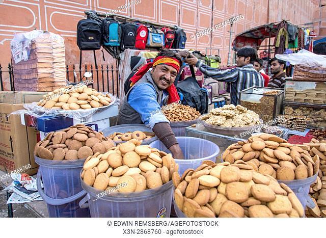 Johri Bazaar; Indian man selling cookies in Jaipur, India