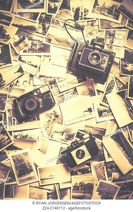 3 vintage analogue cameras on a visual archive of bygone photos. Visual stories from past times