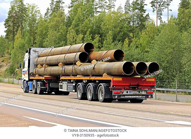 Orivesi, Finland - August 27, 2018: Volvo FH12 semi trailer of Seikkala Logistics Oy transports metallic pipes along highway 4 in early autumn, rear view