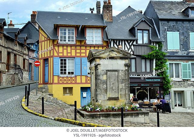 Old town of Honfleur, old fountain, restaurant with tourists Calvados, Normandy, France