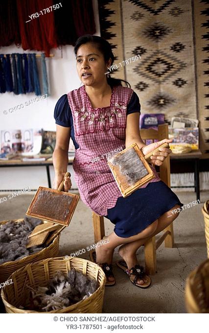 A female weaver works with wool in a weaving studio in Teotitlan del Valle, Oaxaca, Mexico