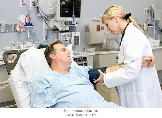 Doctor taking patient's blood pressure