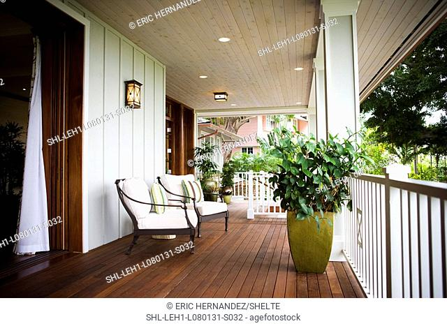 Two chairs on front porch of Hawaiian home