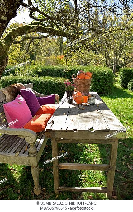 Garden table with autumnal decoration
