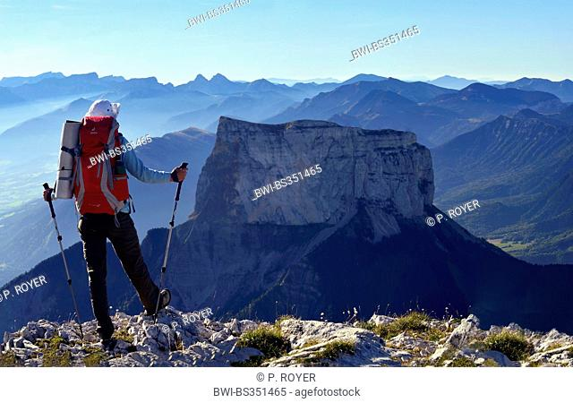 mountain hiker enjoying the view to Mont Aiguille in the morning, France, Isere, Vercors National Park