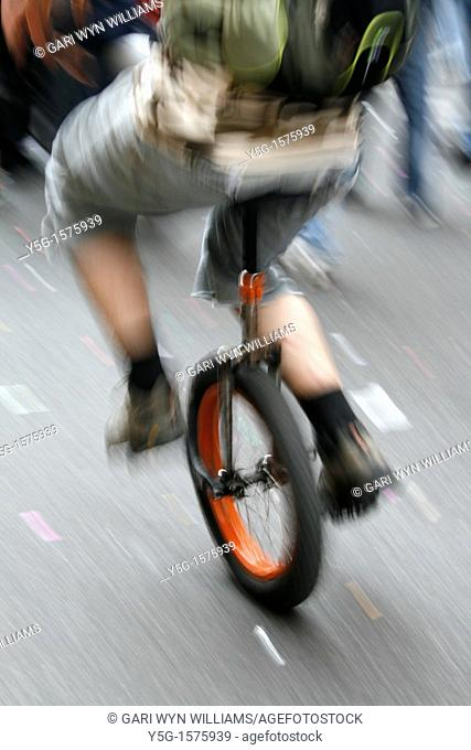 fast unicycle rider in town