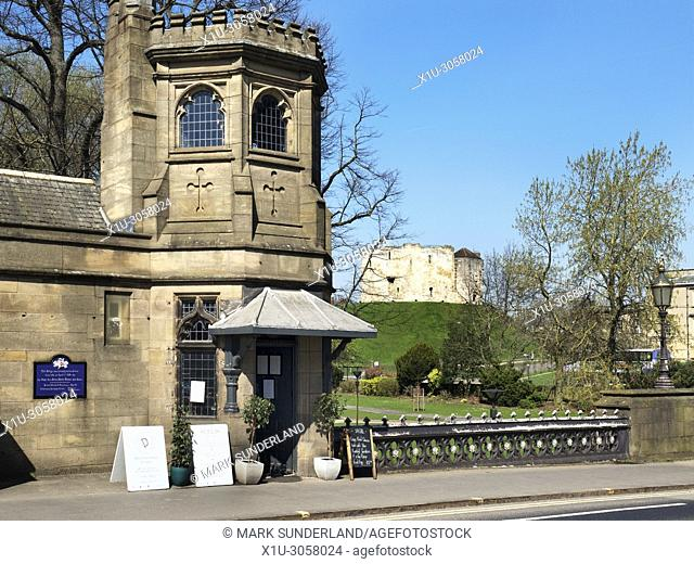 Old toll house on Skeldergate Bridge with Cliffords Tower beyond York Yorkshire England