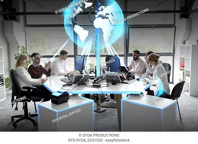 business team with earth hologram at office