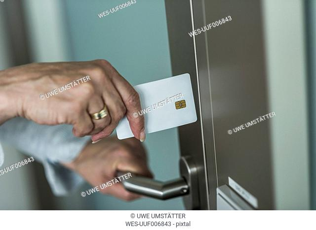 Woman opening door with chip card