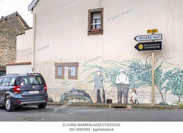 Car on road at Sermiers Reims Marne Grand Est France Mural on house