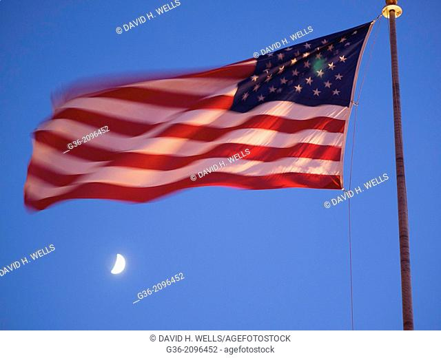 Fluttering American flag during moonlight, Pismo Beach, California