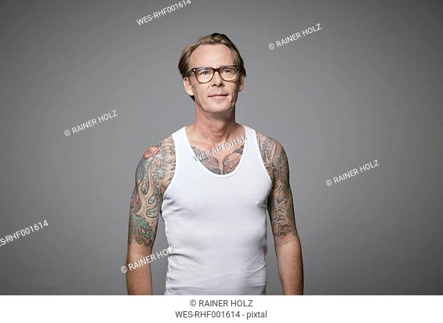 Portrait of tattooed man wearing vest