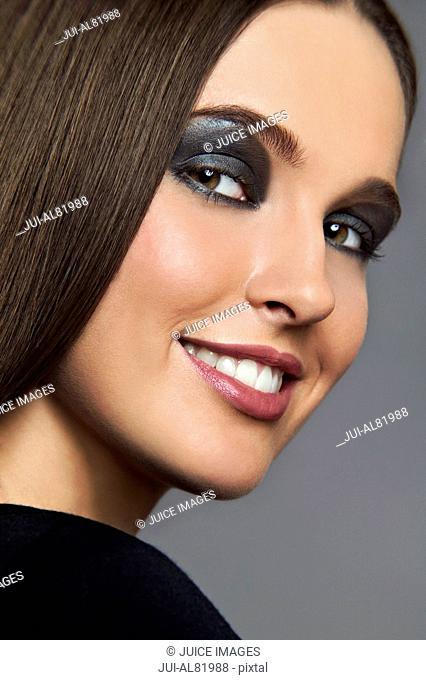Studio shot of woman with dark eye makeup