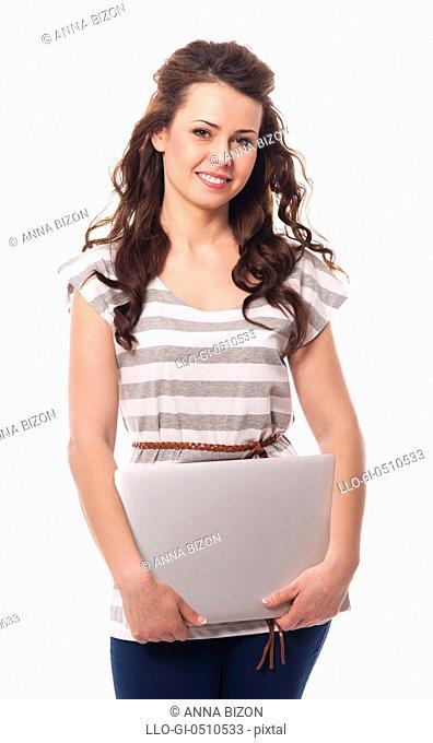 Smiling woman holding contemporary laptop Debica, Poland