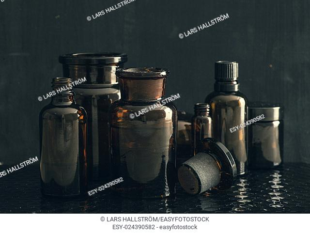 Old style medicine glass bottles. Concept of science research, healthcare and laboratory tests