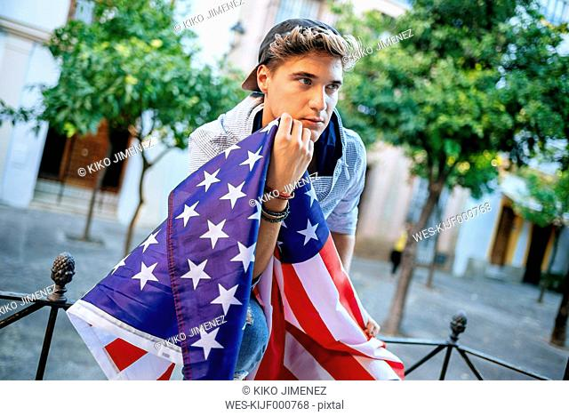 Portrait of young man with American flag