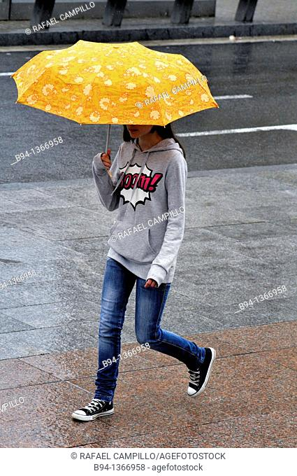 Girl with umbrella, Barcelona, Catalonia, Spain